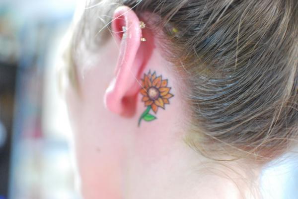 http://favimages.net/wp-content/uploads/2013/11/small-sunflower-tattoo-pics-ear.jpg