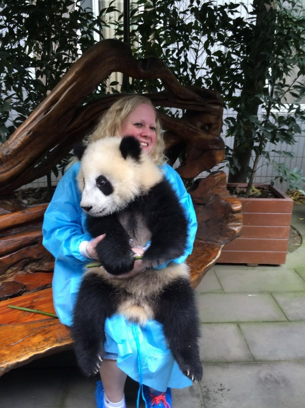 Beautiful and cute panda sitting with woman