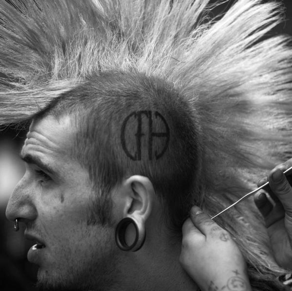 Punk rock festival in England, mans haircut