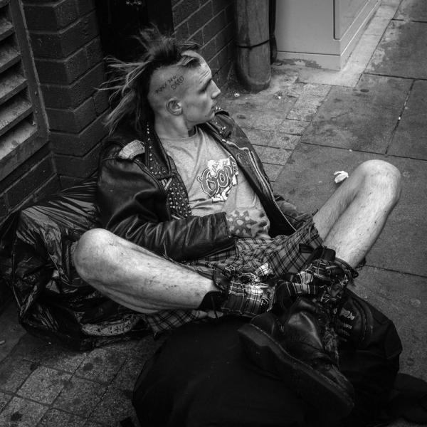 Punk rock festival in England, resting man
