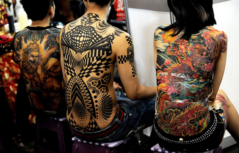 Exhibition of tattoos and body art in Sydney back