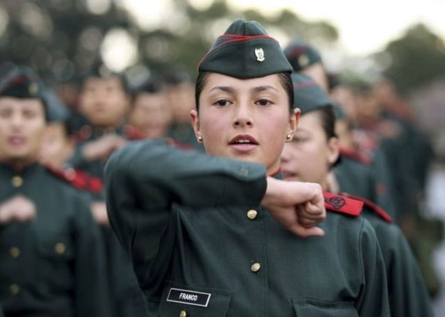 A female cadet marches in a military training school in Bogota