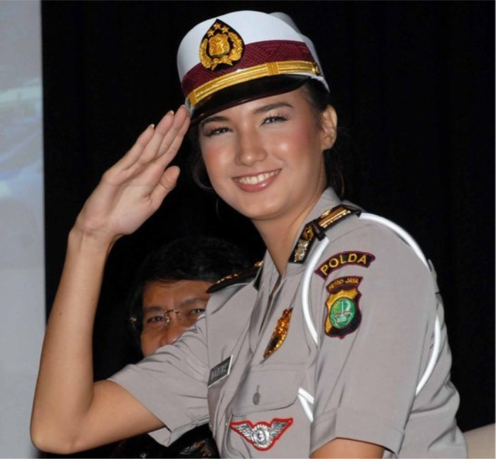 Woman in military uniform, Indonesia