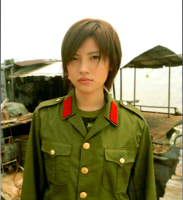 Woman in military uniform, Vietnam